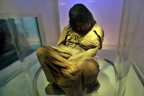 """The mummy """"La Doncella"""" (The Maiden) is displayed at the MAAM's museum """"Museo de Arqueologia de Alta Montana"""" in Salta, Argentina, some 1600  kilometers from Buenos Aires, Thursday Sept.6, 2007. """"La Doncella"""" was approximately 15 years old when she was offered together with two younger children, that were part of a sacrifice made to Gods by Indigenous Inca more than 500 years ago on the top of the  LLullaillaco volcano. The mummies are very well preserved due to the conditions of the place they were undercovered by scientific on 1999 (low atmospheric pressure, low oxygen levels, absence of bacteria, lack of solar light and the most important factor: intense cold of the mountain). """"La Doncella"""" is being showed to the public for the first time since Wednesday Sept.5, 2007. (AP Photo/Natacha Pisarenko)"""